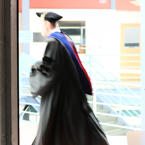 faculty walking in graduation robe