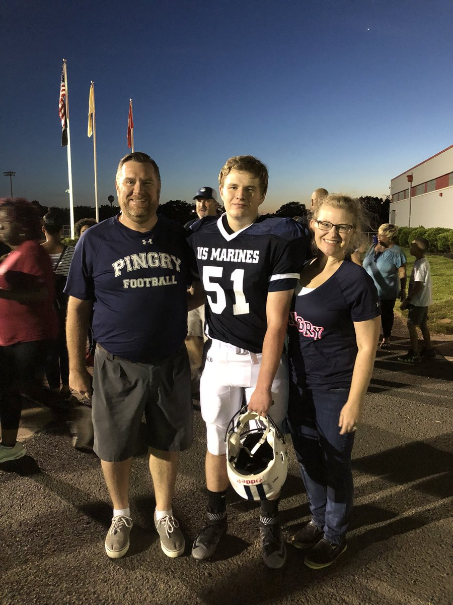 A.J. Weaver poses with his parents at the 2018 Basilone Bowl